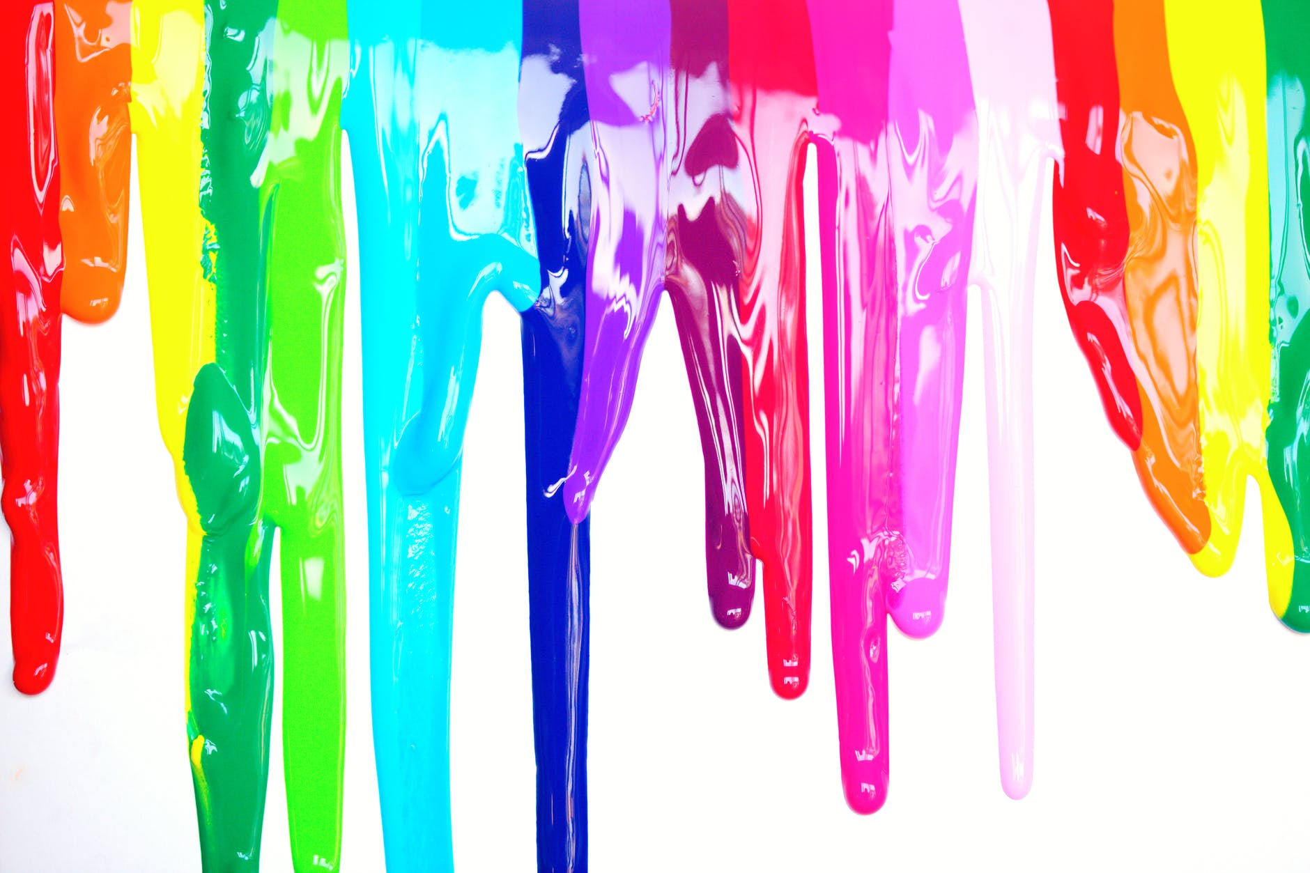 dripping paint in rainbow colors to represent gender diversity and queer rights